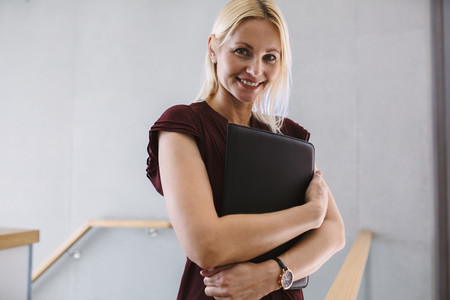 Businesswoman standing in the office holding file