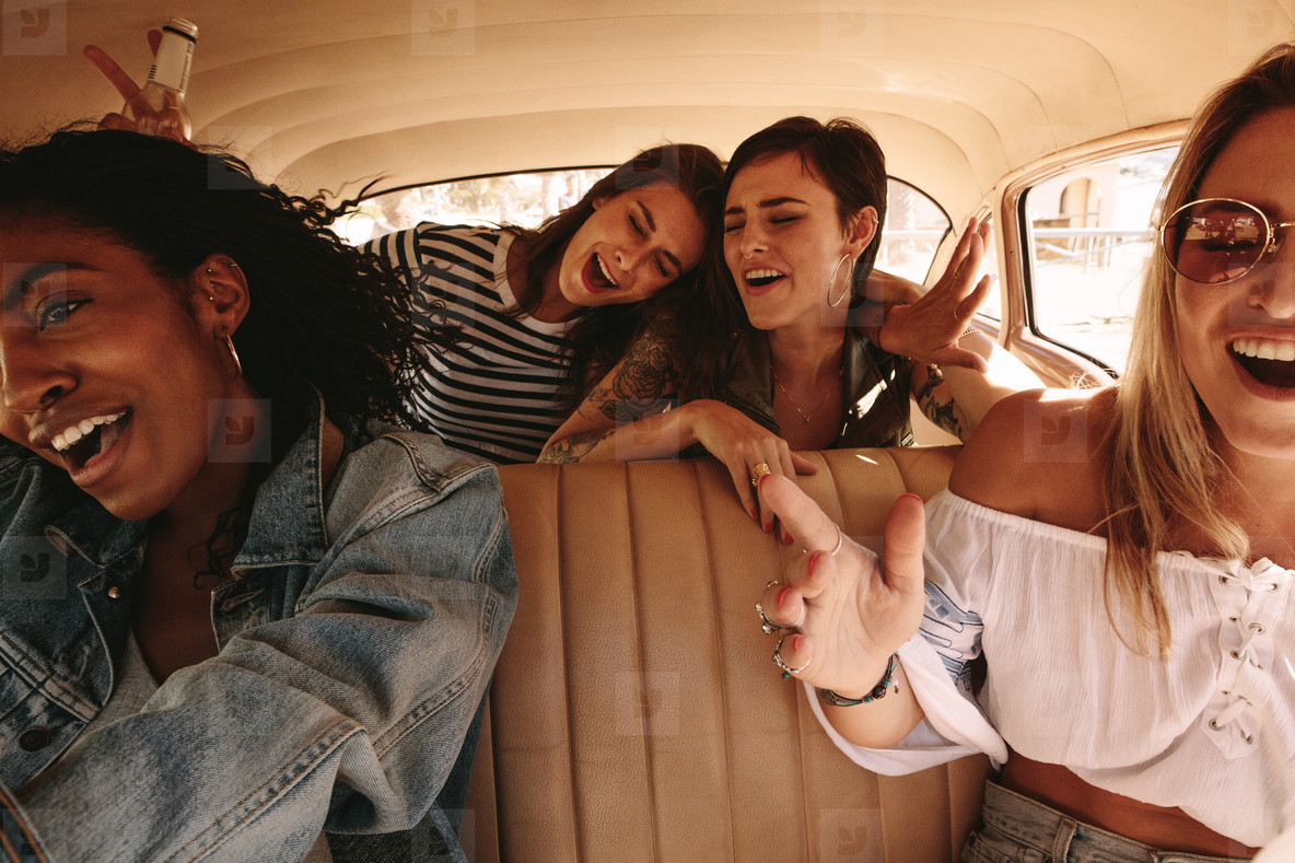 Girls having great time on road trip