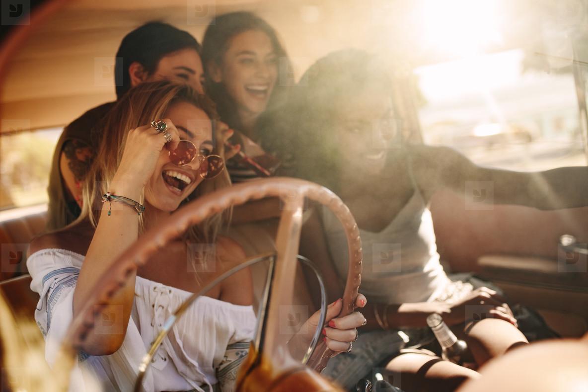 Young women enjoying on the road trip