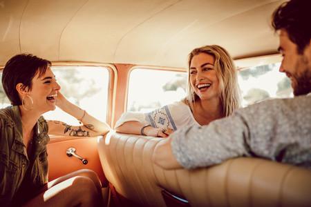 Friends having fun in a car