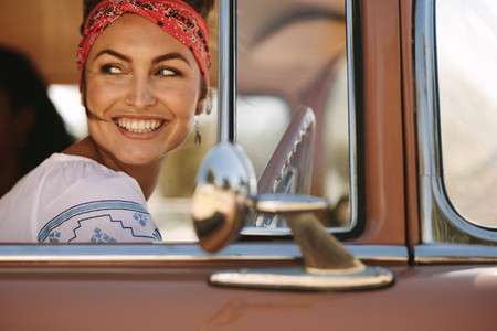 Woman looking outside while driving