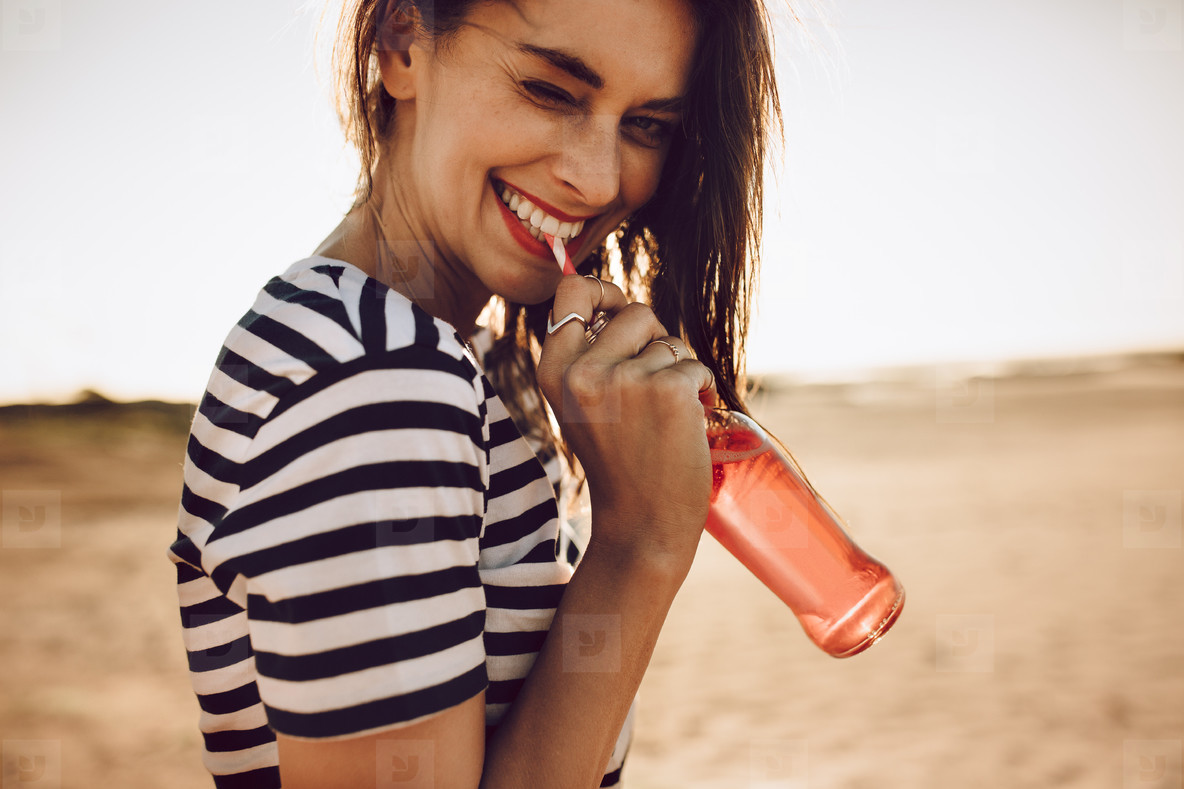 Sweet young girl drinking a soda