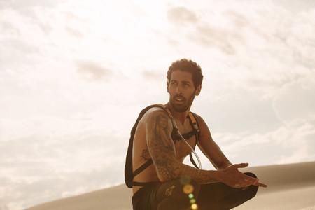 Male athlete taking a break from workout in desert
