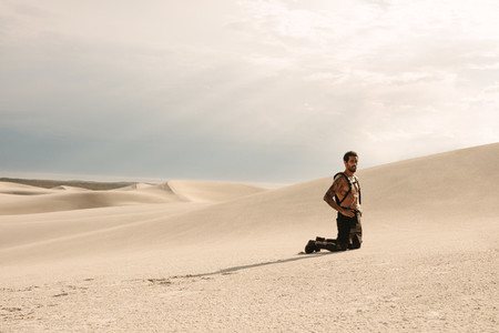 Athlete in desert taking rest after workout