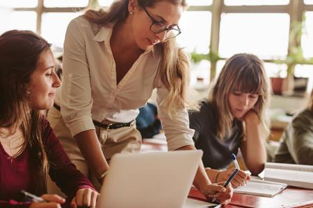 Teacher helping students study