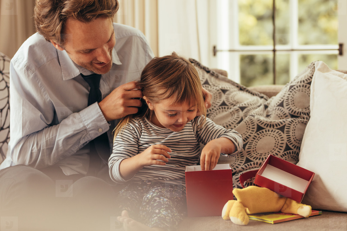Father and daughter opening a gift box