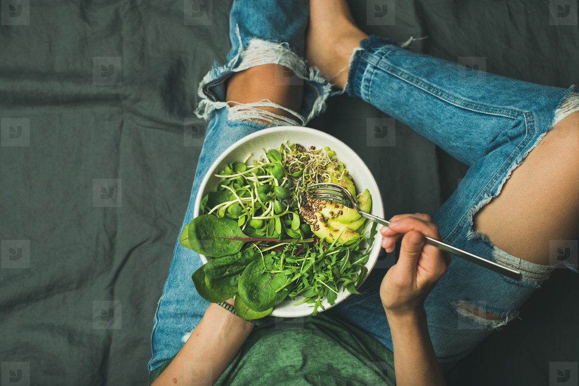 Vegetarian breakfast bowl with spinach  arugula  avocado  seeds and sprouts