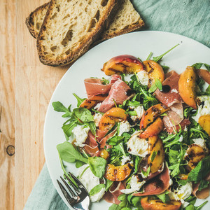 Arugula  prosciutto  mozzarella and grilled peach salad  top view