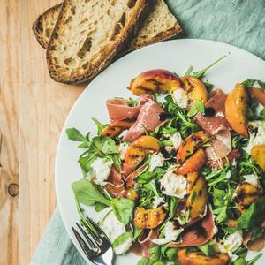 Arugula  prosciutto  mozzarella and grilled peach salad  top view