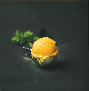 Mango sorbet ice cream scoop square crop copy space