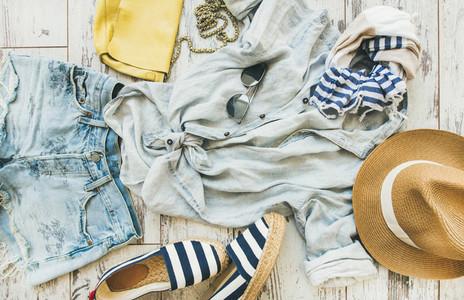 Pastel coloured summer womens clothes parquet background