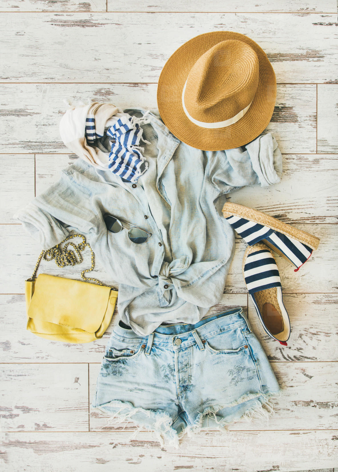 Pastel summer womens clothes  parquet background  top view