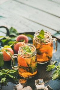Summer refreshing cold peach ice tea on table  copy space