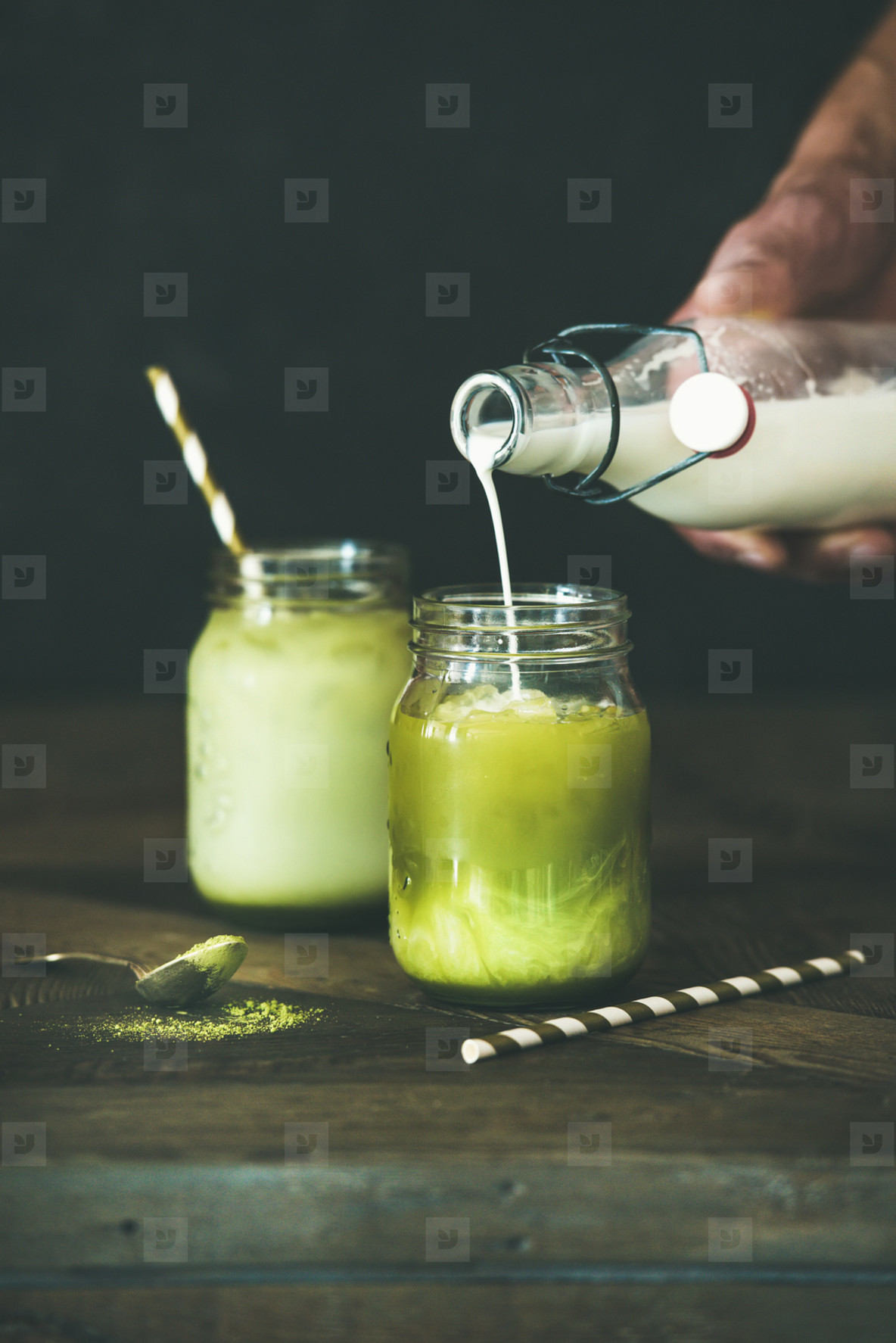 Cold refreshing summer iced coconut matcha latte drink