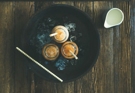 Cold Thai iced tea with milk  top view  copy space