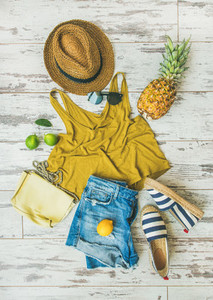 Colorful summer fashion outfit flat lay over pastel background
