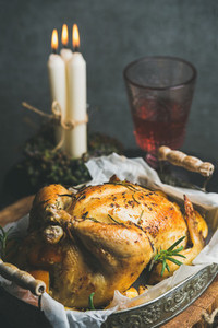 Christmas and New Year table set with roasted whole chicken