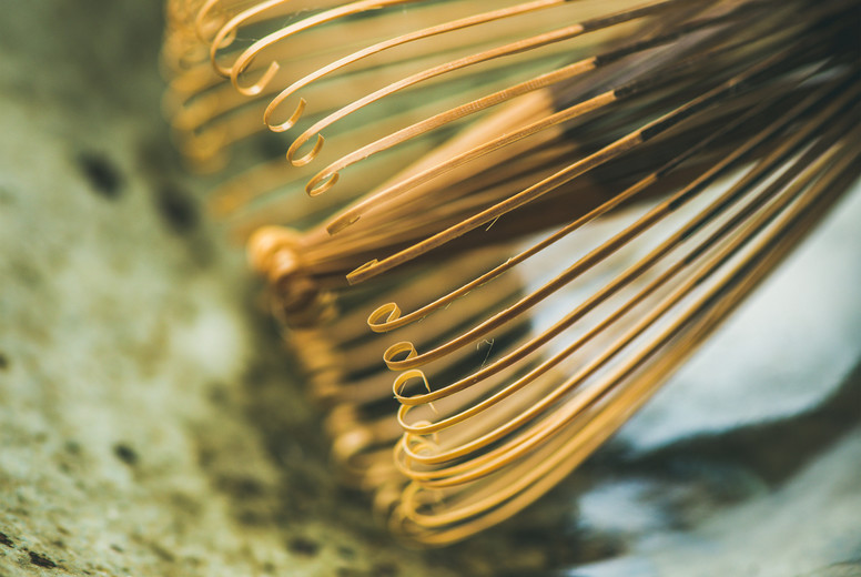 Close up of traditional Japanese Chasen whisk and Chawan bowl