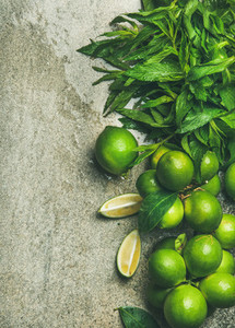 Flatlay of fresh limes and mint for making cocktail  lemonade