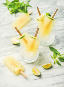 Summer refreshing lemonade popsicles with lime and mint