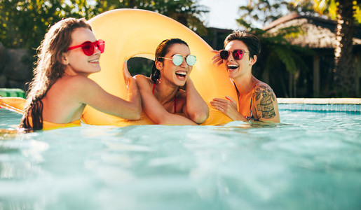 Female friends enjoying summer at pool