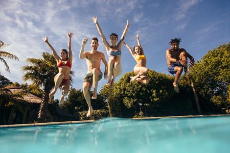 Friends having fun at holiday resort pool