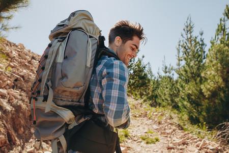 Male hiker trekking on mountain