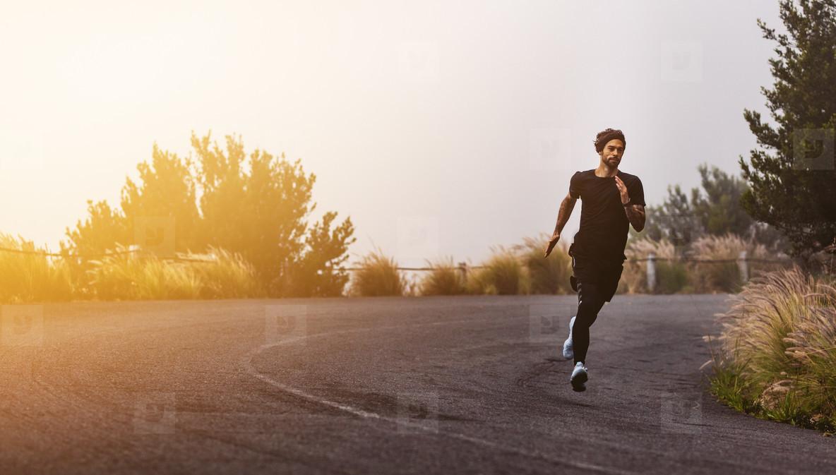 Athlete running on mountain road