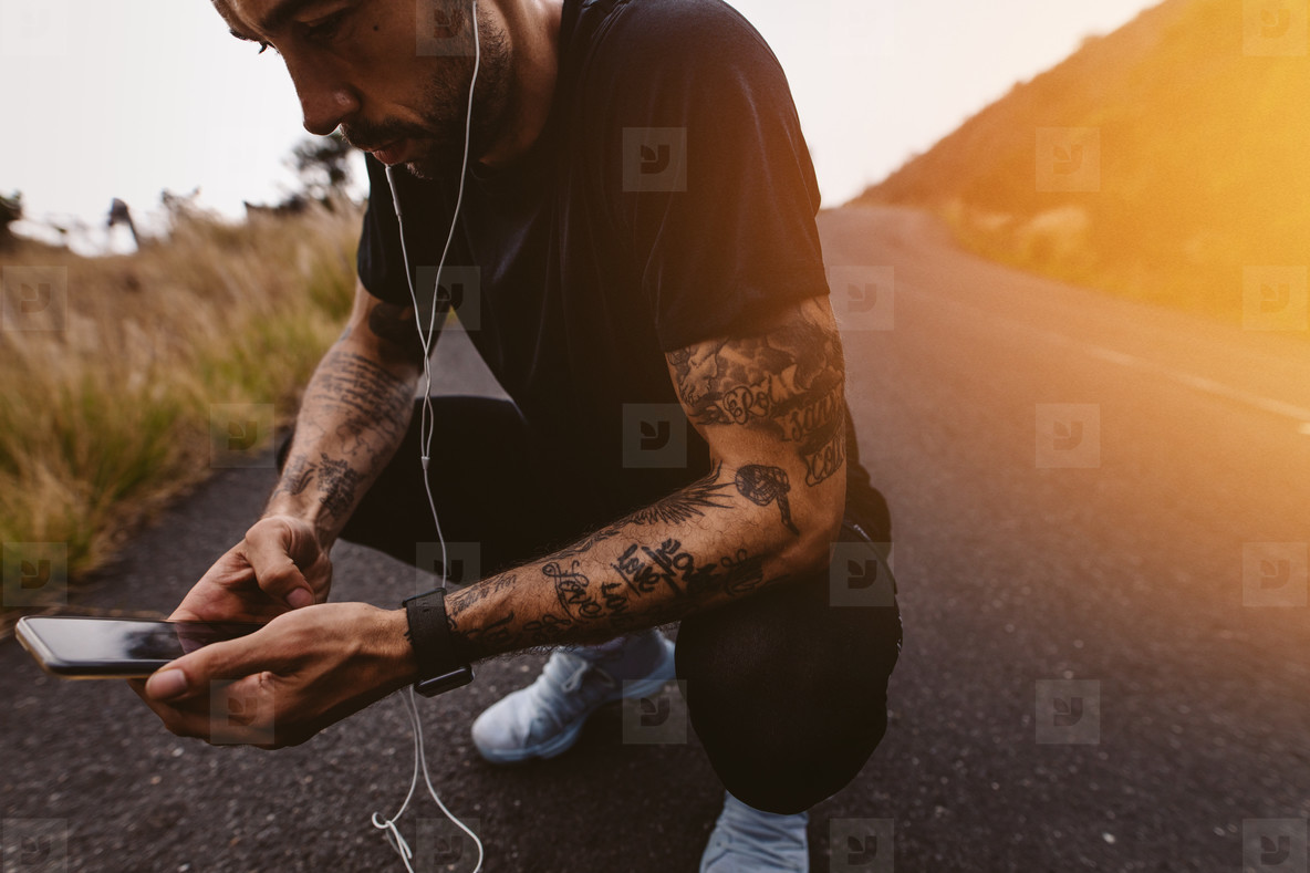 Man taking a break after jogging