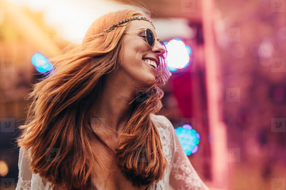 Beautiful hippie woman enjoying at music festival