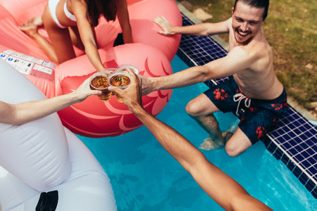 Group of friends partying in a pool