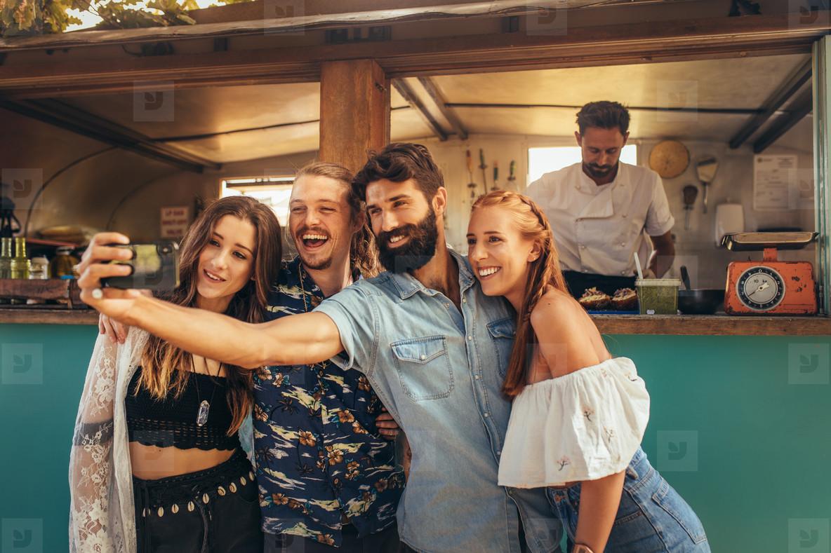 Millennial friends group taking selfie