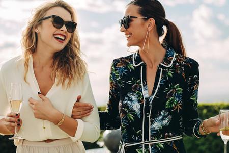 Beautiful women walking and talking outdoors