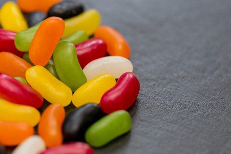 Jelly beans candy sweets dark background with copy space