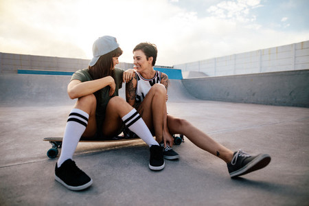 Friends enjoying spending time together at skate park