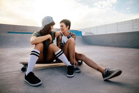 Friends enjoying spending time together at skate park