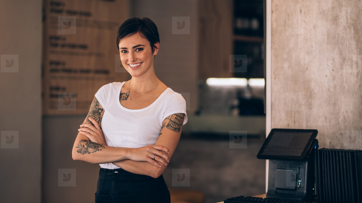 Attractive female cafe owner