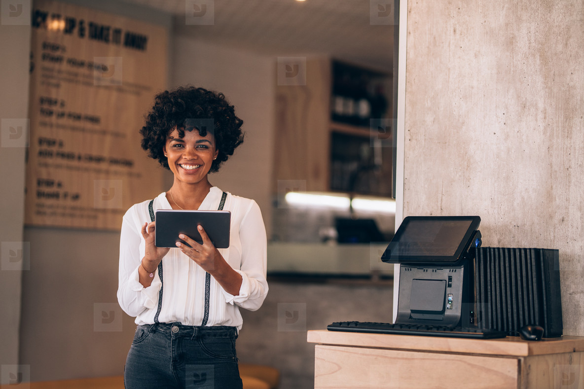 Female restaurant manager with a digital tablet