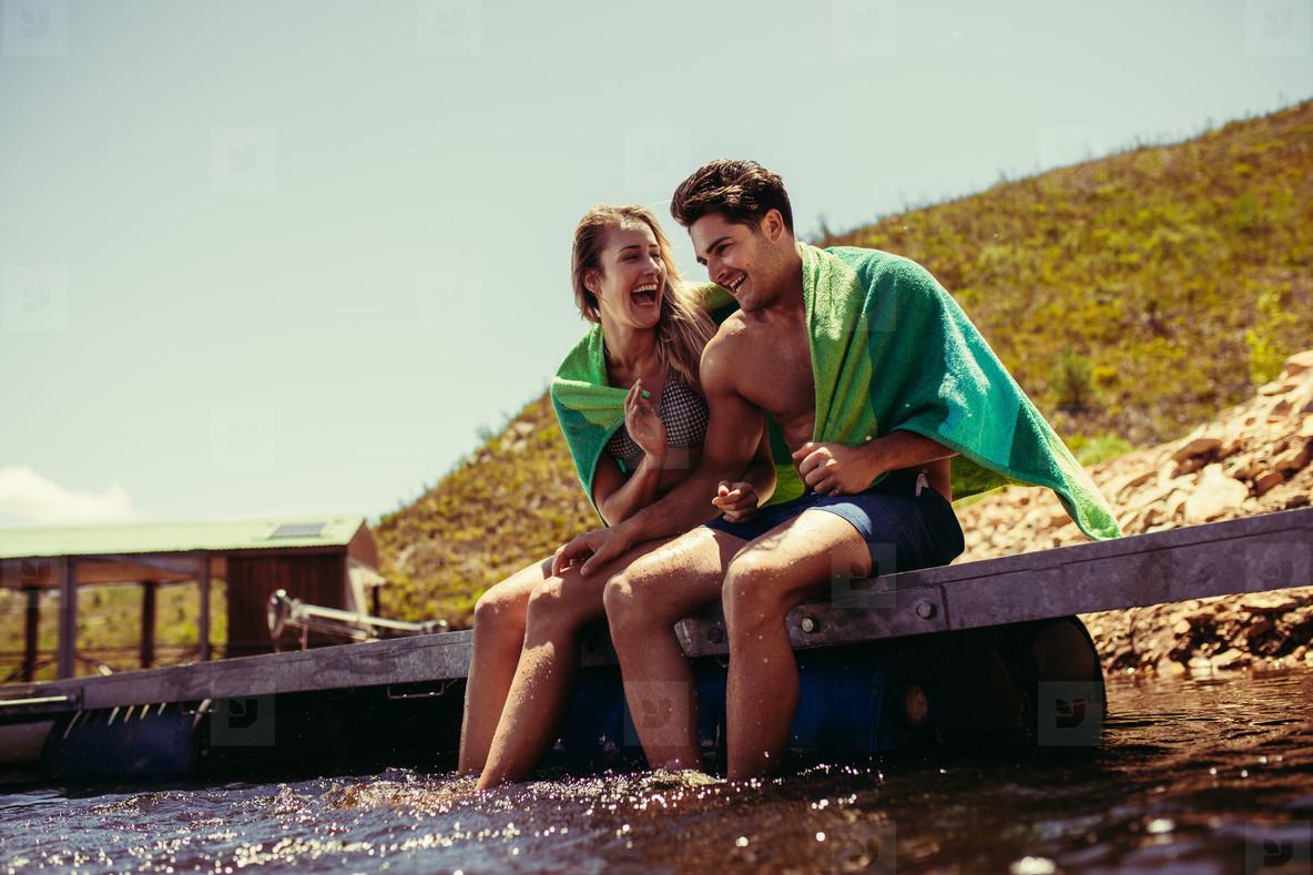 Couple enjoying on pier at the lake