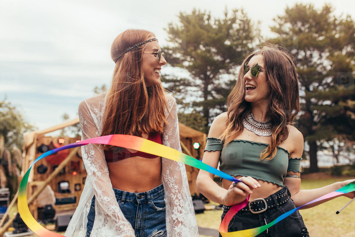 Young women enjoying at music festival