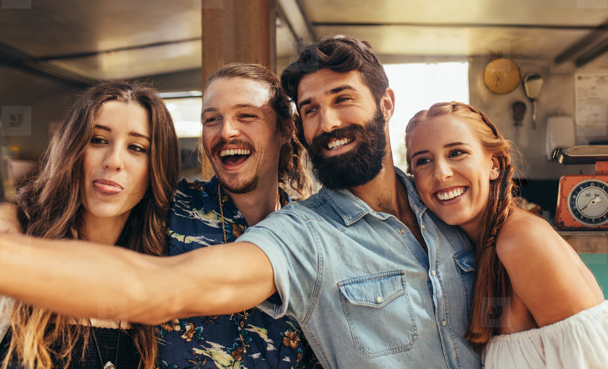 Group of friends making selfie at outdoors