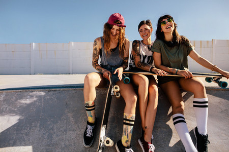 Group of smiling women at skate park