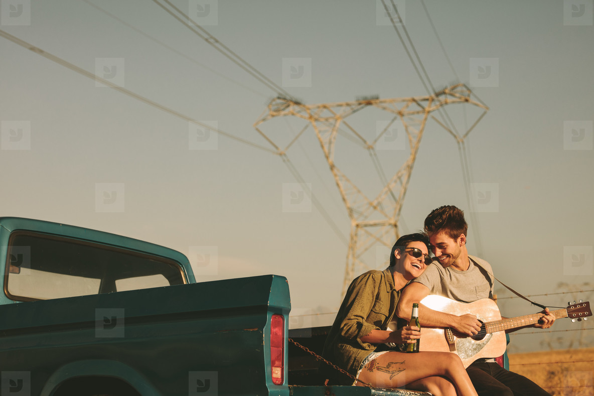 Couple enjoying on a road trip in their pick up truck