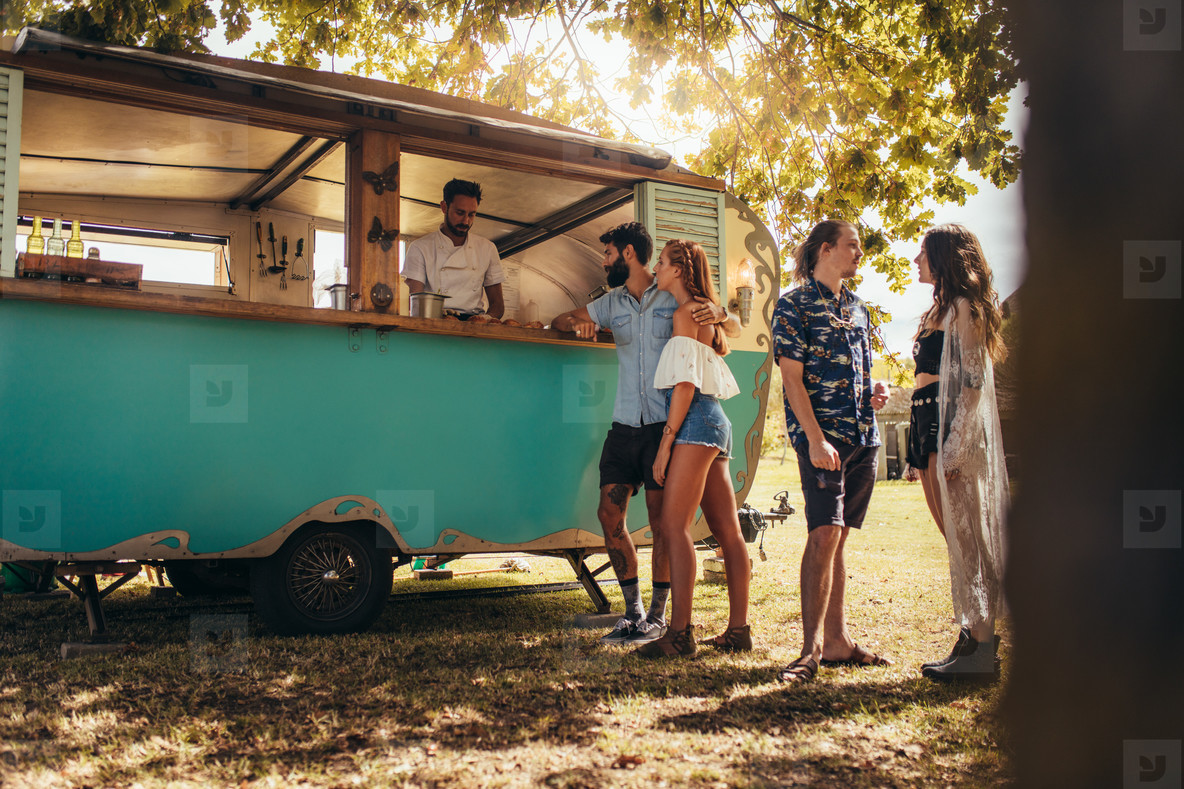 Group of young people at food truck
