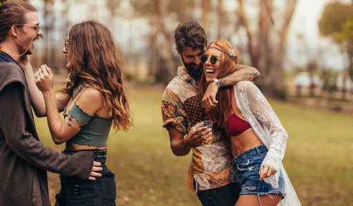 Hippie friends having a great time at music festival