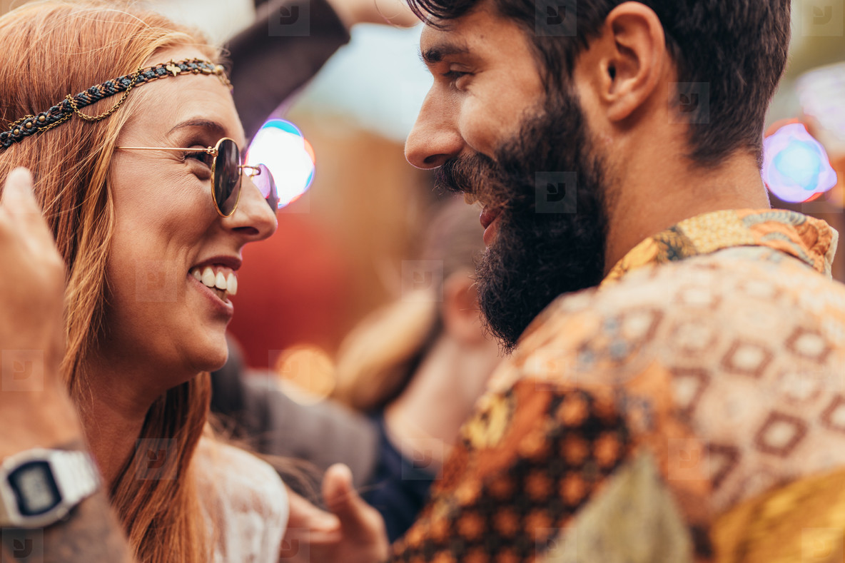 Hippie couple dancing at music festival