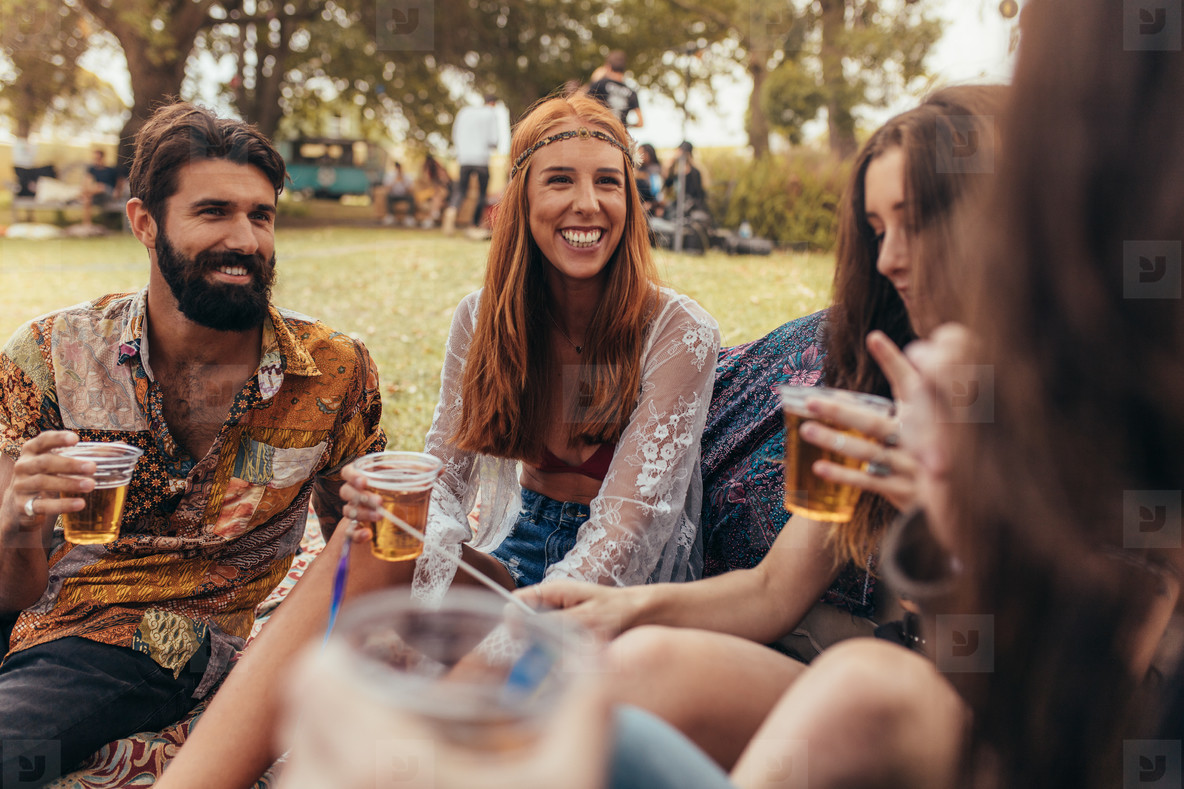 Young hippie friends partying at park
