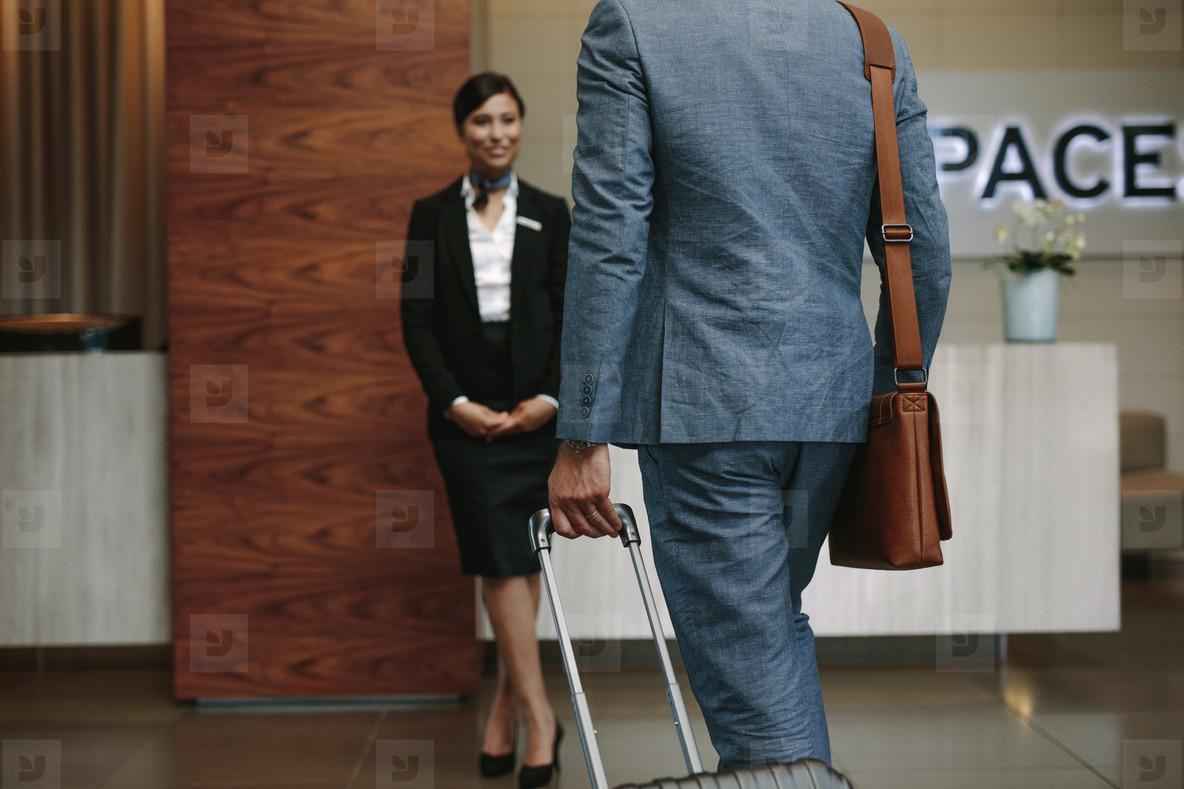Businessman arriving at hotel for conference