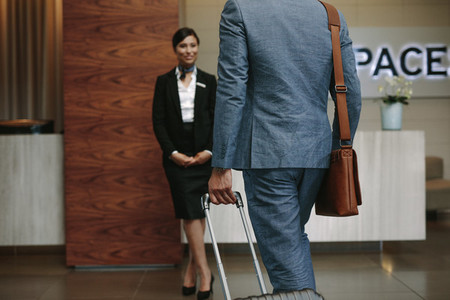 Businessman arriving at hotel for conference