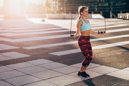 Woman doing jump rope cardio